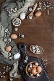 Easter eggs in chicken and quail. With willow twigs on wooden background, top view Royalty Free Stock Photography