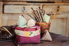 Easter eggs and chicken in quilt handmade bag in country house Royalty Free Stock Photo