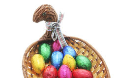 Easter Eggs in Chicken-shaped Cane Basket Stock Image