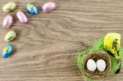 Easter eggs and chicken on wooden background Royalty Free Stock Photography