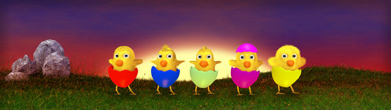 Easter eggs and chickens on meadow Stock Photography