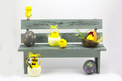 Easter eggs and chicks, in a bench Royalty Free Stock Images
