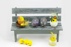 Easter eggs and chicks, in a bench Stock Photo