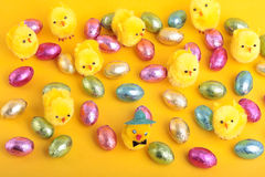 Easter eggs and chicks  over yellow background Stock Photography
