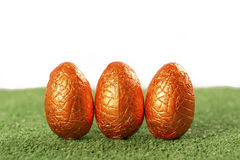 Easter eggs chocolate on grass royalty free stock photo