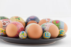 Easter eggs and chocolates on white plate Stock Image