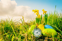 Easter eggs and a clock Stock Photography
