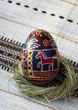 Easter eggs close-up with a painted red horse stock images