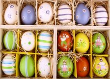 Easter eggs collection in wooden box closeup Royalty Free Stock Images