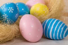 Easter eggs with colored eggs in nest stock photography