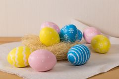 Easter eggs with colored eggs in nest royalty free stock photography
