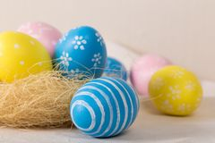 Easter eggs with colored eggs in nest royalty free stock image