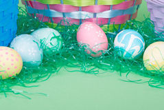 Easter Eggs with Colored Grass Stock Images