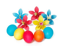 Easter eggs and colored paper flowers Royalty Free Stock Photos