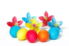 Easter eggs and colored paper flowers stock photo