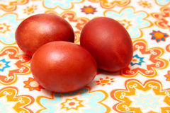Easter eggs on colored tablecloths. Traditional red Easter eggs on colored tablecloths Stock Photography