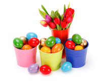 Easter eggs in colored tin buckets Royalty Free Stock Photo