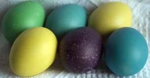 Easter eggs. Colored eggs on white cloth Royalty Free Stock Photography