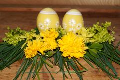 Easter eggs and colorfol flowers Royalty Free Stock Image