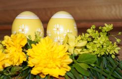 Easter eggs and colorfol flowers Stock Photography