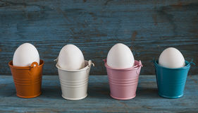 Easter eggs in colorful buckets Royalty Free Stock Photo