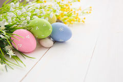 Easter Eggs. Colorful decorated easter eggs on white wood background. Happy Easter royalty free stock photography