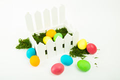 Easter eggs. Colorful dyed eggs for Easter in a basket on white backgroundn Stock Image