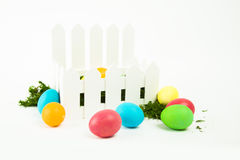 Easter eggs. Colorful dyed eggs for Easter in a basket on white backgroundn Royalty Free Stock Photography