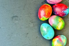 Easter eggs. Colorful easter hand painted eggs on blak background Stock Image