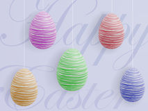 Easter eggs. Colorful Easter eggs hanging on ropes with the inscription in the background Royalty Free Stock Images