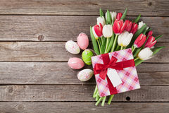 Easter eggs and colorful tulips Stock Photo