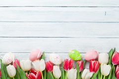 Easter eggs and colorful tulips Royalty Free Stock Photo