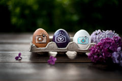 Easter eggs. Colorful Easter eggs on a wooden table with lilac Stock Photography