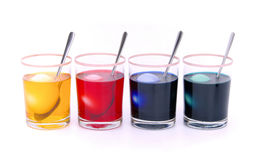 Easter eggs colour. Easter egg dyeing, egg and glasses Stock Photos