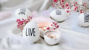 Free Easter Eggs Composition. Easter Message, Words Drawn With Pen. High Angle View Of Shells On Table. Live. Candle In Egg Shell. Royalty Free Stock Images - 211328409