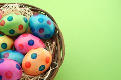 Easter Eggs with copy space. Colorful easter eggs in a nest with green background Royalty Free Stock Photos