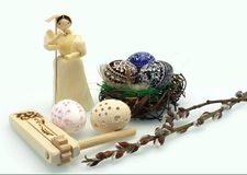 Easter eggs and corn dolls Royalty Free Stock Photography