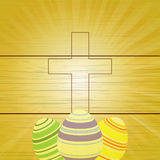Easter eggs and Cross on wooden background Stock Image