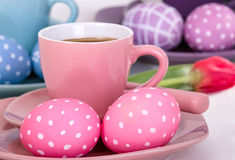 Easter eggs with a cup of coffee Royalty Free Stock Photo
