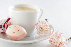 Easter eggs with cup of coffee Stock Photos