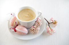 Easter eggs with cup of coffee Royalty Free Stock Images