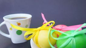 Easter eggs and Cup of coffee with steam stock footage