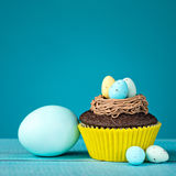 Easter Eggs and Cupcake Stock Image