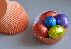 Easter eggs in cupcake  containers Royalty Free Stock Photography