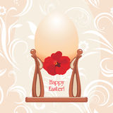 Easter eggs in a cups on the ornamental background Royalty Free Stock Photos