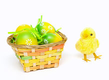 Easter eggs and cute chicken-toy Royalty Free Stock Photo