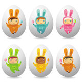 Easter eggs with cute little babies Stock Image