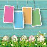 Easter Eggs Cyan Wood Pastel Price Stickers. Price stickers on the wooden background with easter eggs in the grass Royalty Free Stock Photography