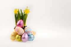 Easter eggs and daffodil Stock Photo