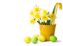 Easter eggs and daffodils in a flowerpot Stock Photo